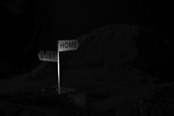 A white sign with two directions: 'home' or 'lost'
